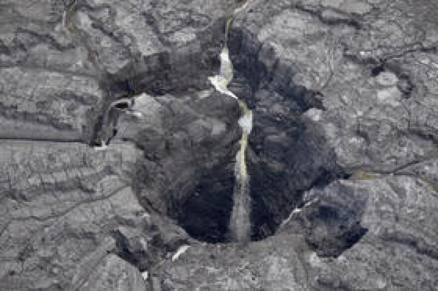 A sinkhole opened up this summer on a gypsum stack at the 1,600-acre Mosaic fertilizer factility in Polk County. Millions of gallons of acidic water poured into the Floridan Aquifer.