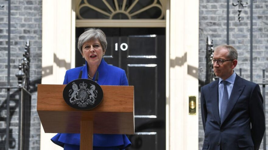 British Prime Minister and leader of the Conservative Party Theresa May, accompanied by her husband Philip, speaks outside No. 10 Downing St. in central London on Friday.