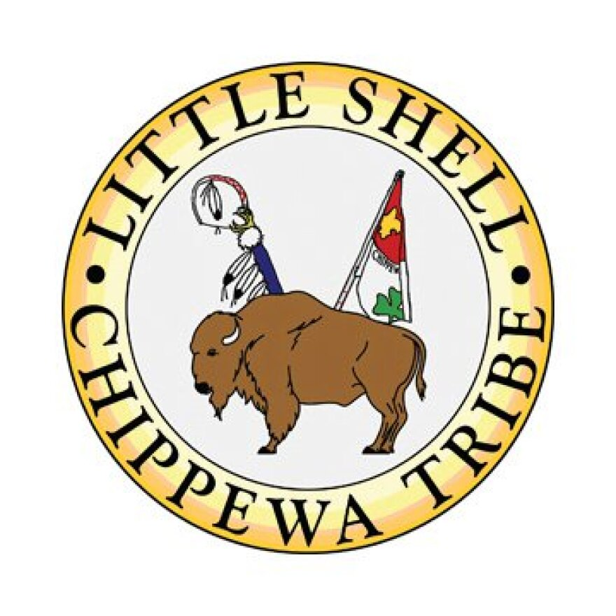 The Little Shell Tribal Seal, with yellow bordering and a buffalo center.