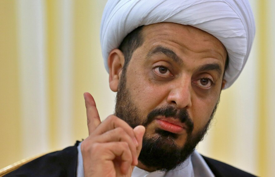 Qais al-Khazali speaks during an interview with The Associated Press in Baghdad, Iraq, on Jan. 28. He said he expects a vote by the Iraqi parliament calling for the withdrawal of U.S. troops from the country within the next few months.