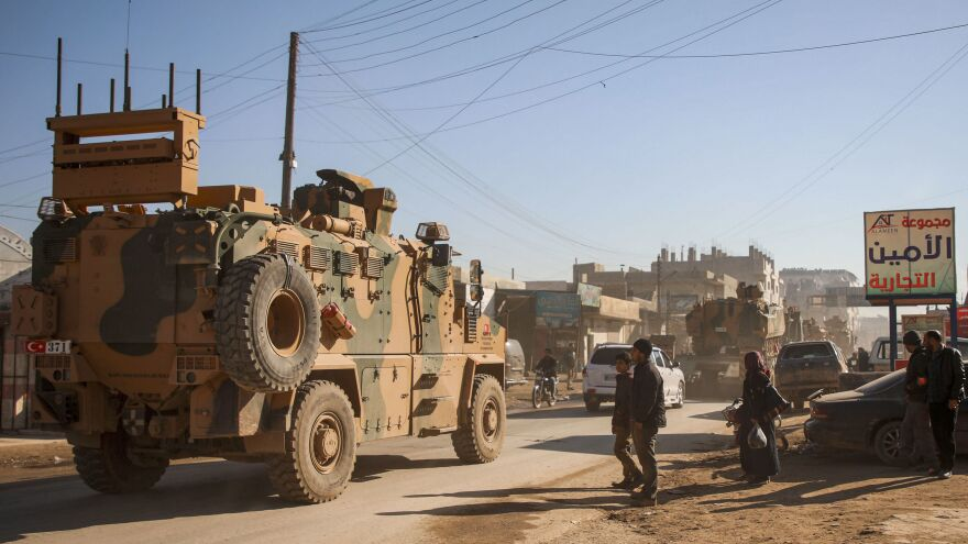 A Turkish military convoy passes through the Syrian town of Dana, in Idlib province near the Turkish-Syrian border, on Sunday. It is there, in northwestern Syria, that friction between the country and neighboring Turkey has flared into direct violence.