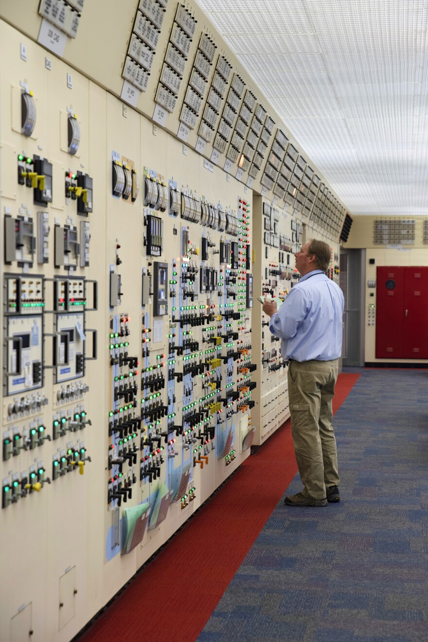 A worker looks at a panel in the control center at Peach Bottom. The site is expanding its temporary storage to hold all the waste generated during the 60 years the plant is licensed to operate.