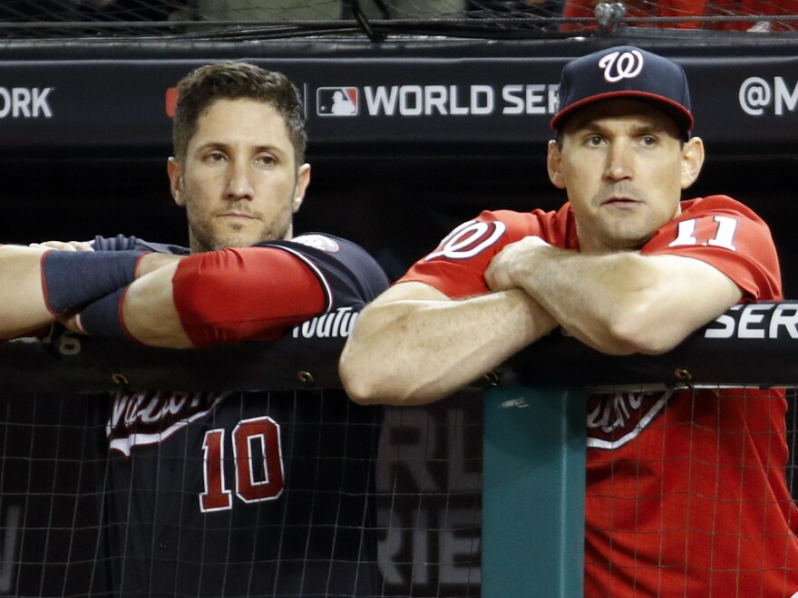 Washington Nationals catcher Yan Gomes, left, and first baseman Ryan Zimmerman watch during the ninth inning of Game 5 of the World Series.