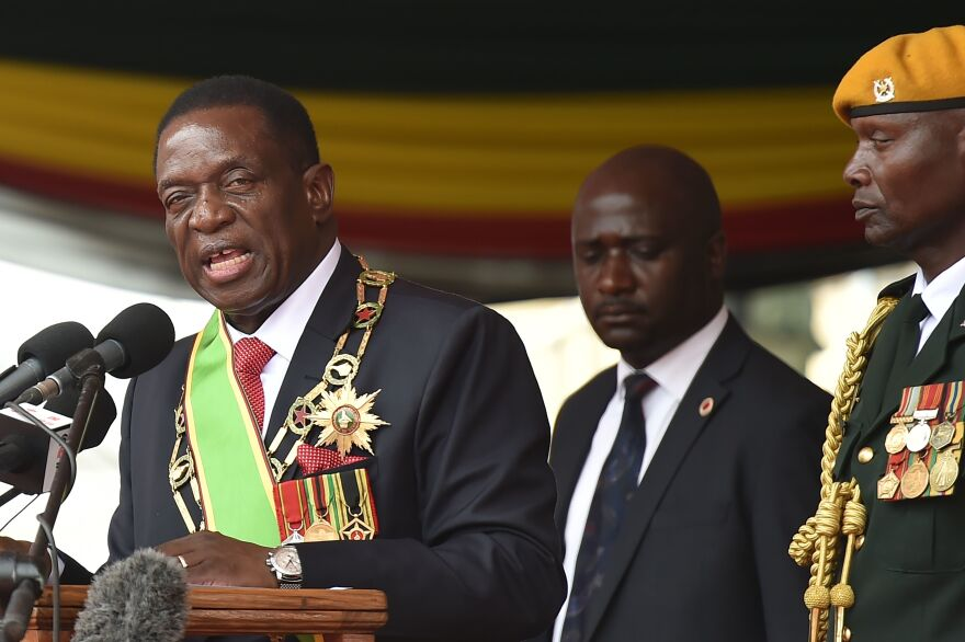 Zimbabwe's new interim President Emmerson Mnangagwa gives an address after his swearing-in ceremony in Harare on Friday, marking the final chapter of a political drama that toppled his predecessor Robert Mugabe after a military takeover.