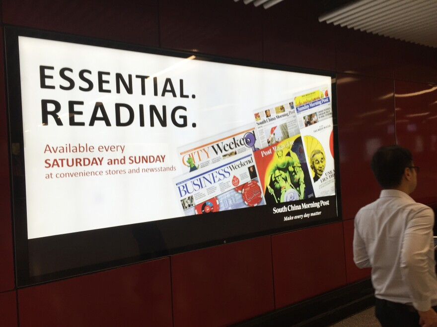 A <em>South China Morning Post</em> advertisement at a Hong Kong subway station.