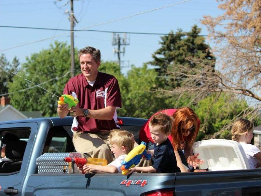 Major Brent Taylor of the Utah National Guard was killed in Afghanistan on Saturday. He was also the mayor of North Ogden, Utah. Taylor is seen here with his family in a July 4 parade in 2014.