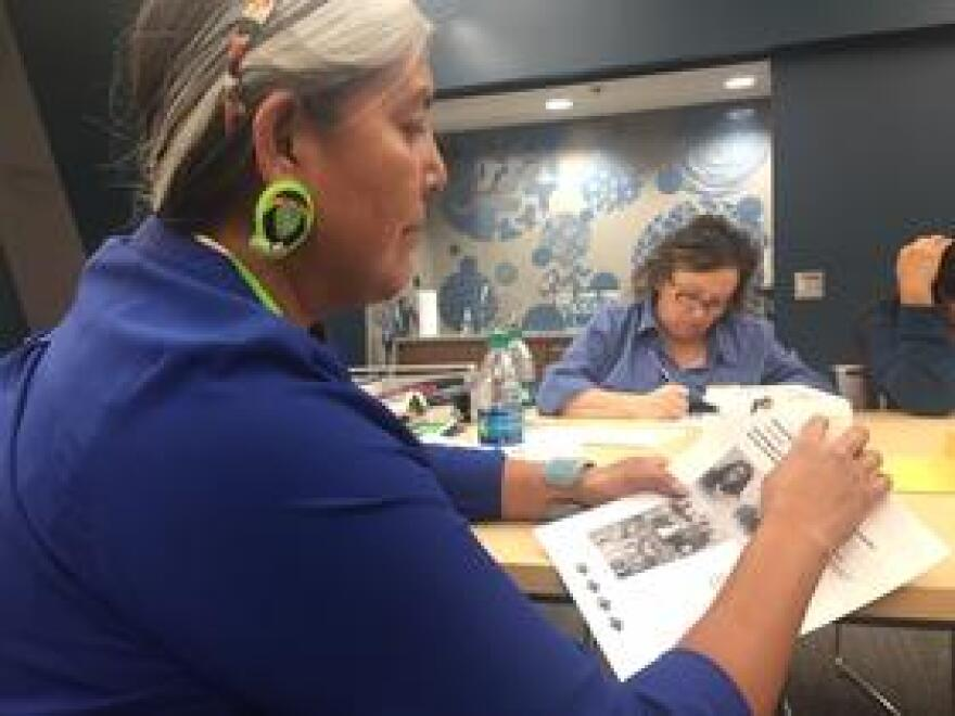Felicia Alvarez (front left), of the Eastern Shoshone tribe, examines a page from one of the new lessons.
