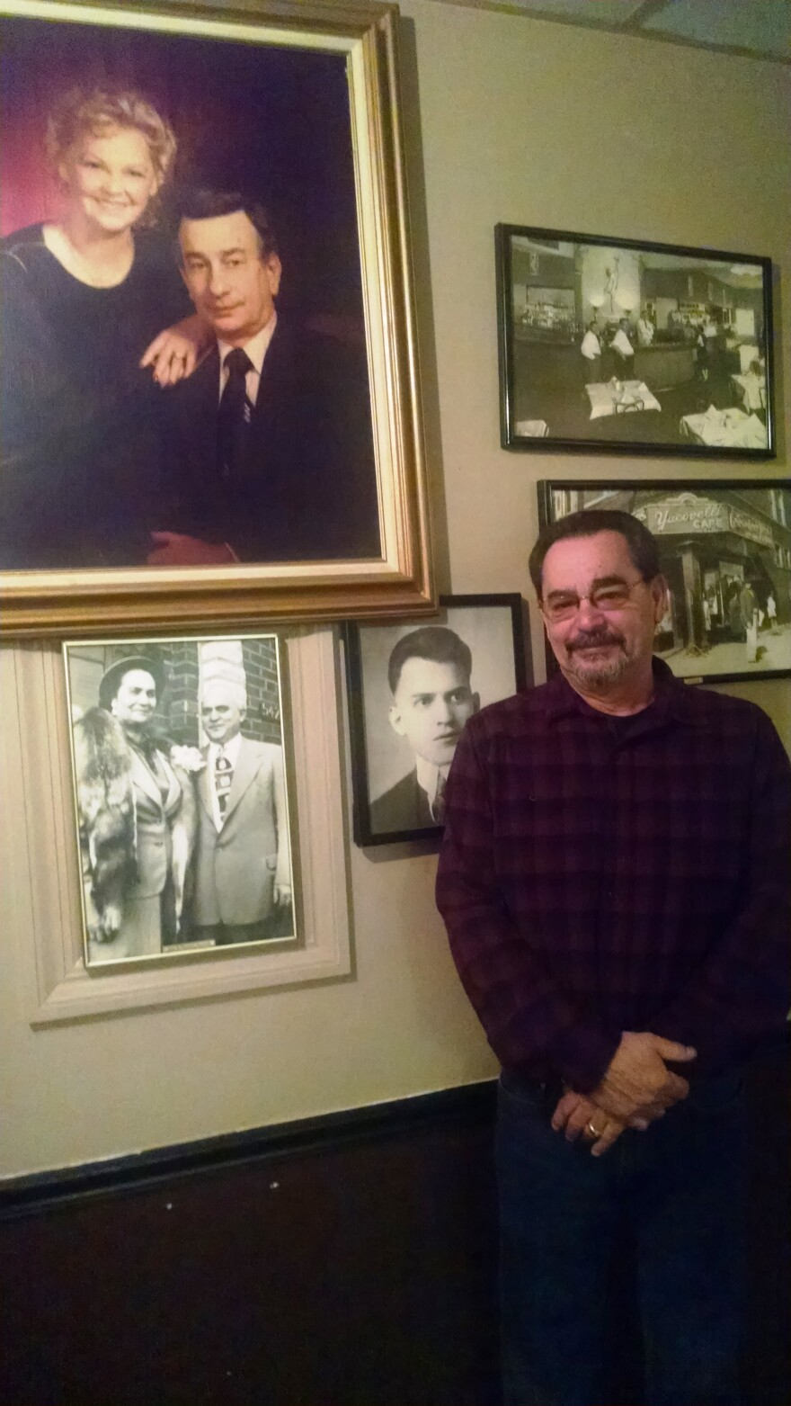 Jack Yacovelli stands besides the pictures of his parents (top) and grandparents (bottom), who were owners of the Yacovelli restaurant before him.
