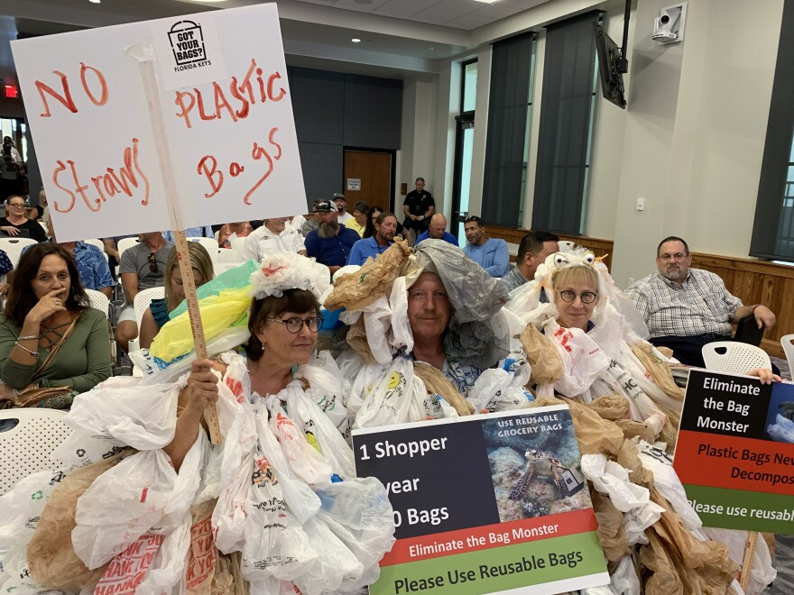 From left, Dolly Garlo, Robert Keeley and Kathy Miklossy dressed up as 'bag monsters' to express their support for a ban of single-use plastics in Key West.