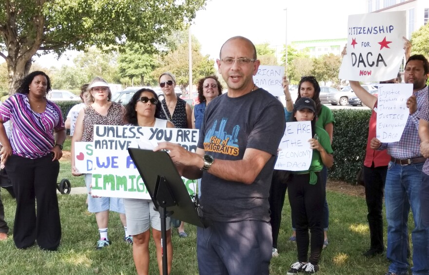 Jose Hernandez-Paris of the Latin American Coalition spoke at a press conference near the Charlotte office of Sen. Thom Tillis Tuesday.