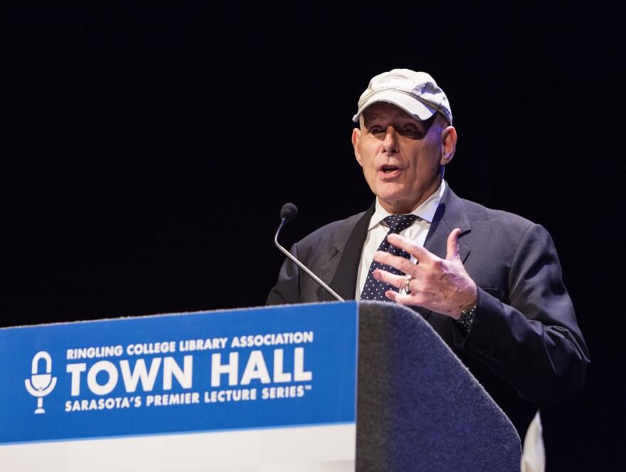 Man at podium speaks