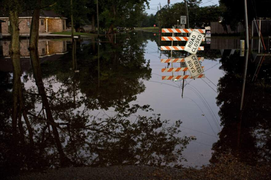Standing water closes roads in Sorrento, La., on Saturday.