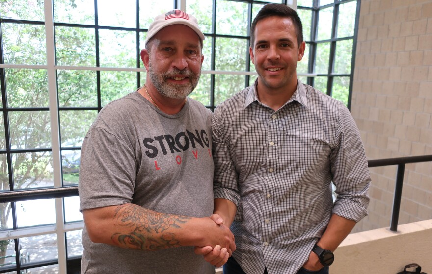 Military members Paul Mott, left, and Brad Pupello talk politics in this week's StoryCorps One Small Step Tampa Bay installment. WUSF STAFF