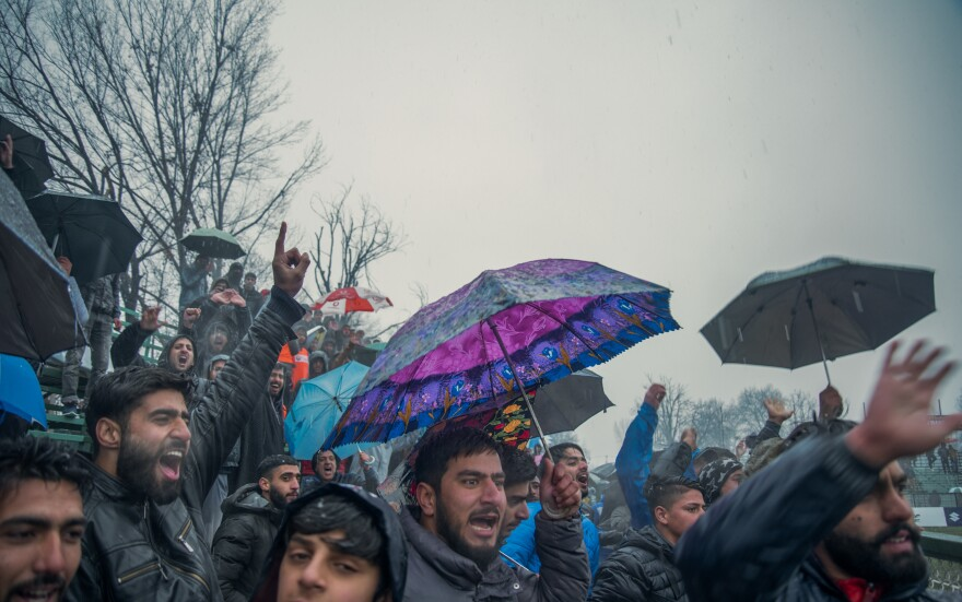 Fans braved sleet and snow to watch Real Kashmir play a home game on Feb. 6 in Srinagar.