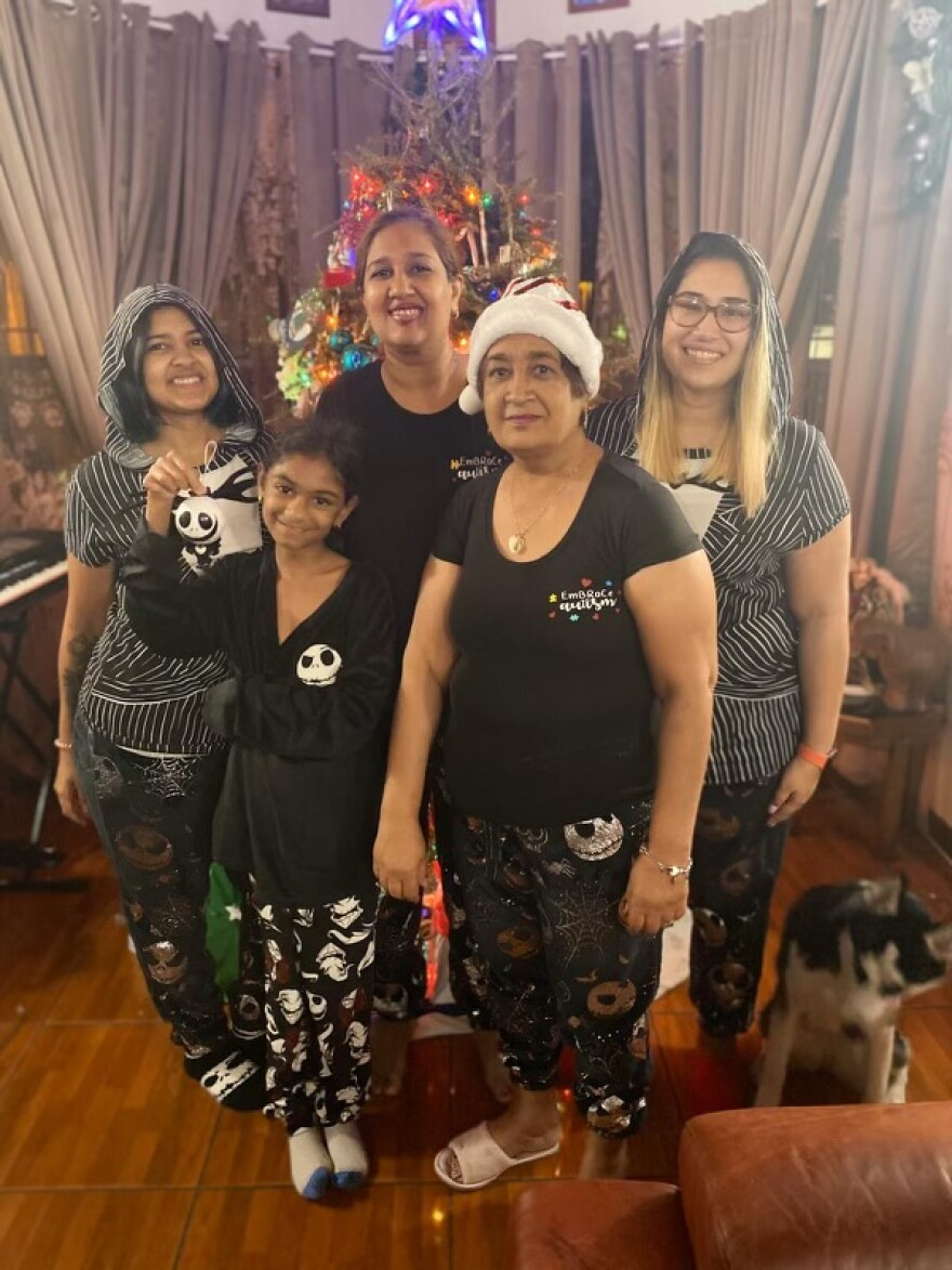 Chandra Haniff (front right) with her granddaugthers and daughter Nicole Tomlin (back center). Haniff died in April from complications with the virus.