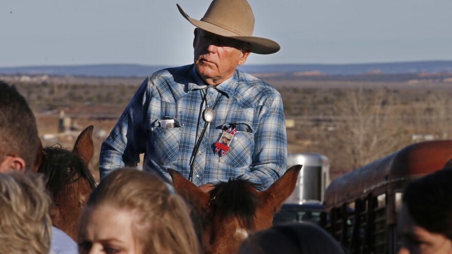 """Cliven Bundy rides a horse after attending the funeral of of fellow rancher Robert """"LaVoy"""" Finicum in February."""