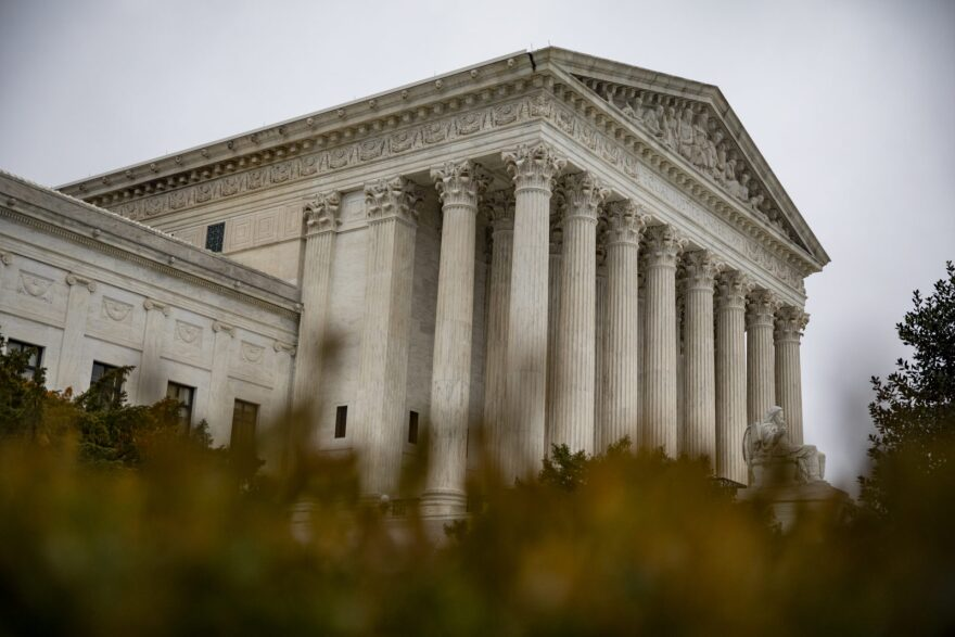 An overcast sky hangs above the U.S. Supreme Court.