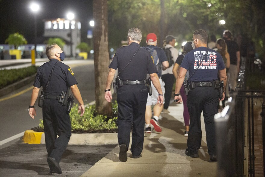 New Port Richey police walk behind protesters