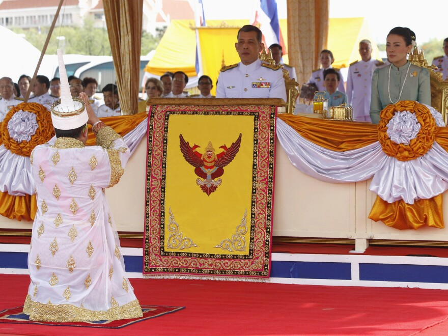Thailand's Crown Prince Maha Vajiralongkorn (seated, left) and Royal Consort Princess Srirasmi, seen during a royal ceremony last year, are now officially divorced, the palace has announced.