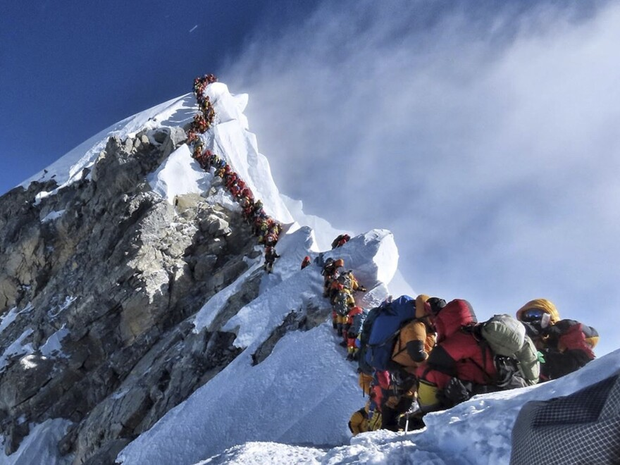 A long queue of mountain climbers line a path on Mount Everest on May 22. Nepal's tourist board says weather conditions and other factors, not crowds, were to blame this month.