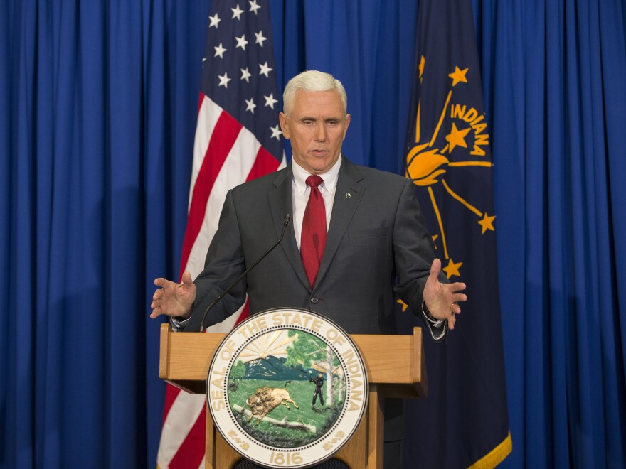 Gov. Mike Pence of Indiana at a press conference last year.