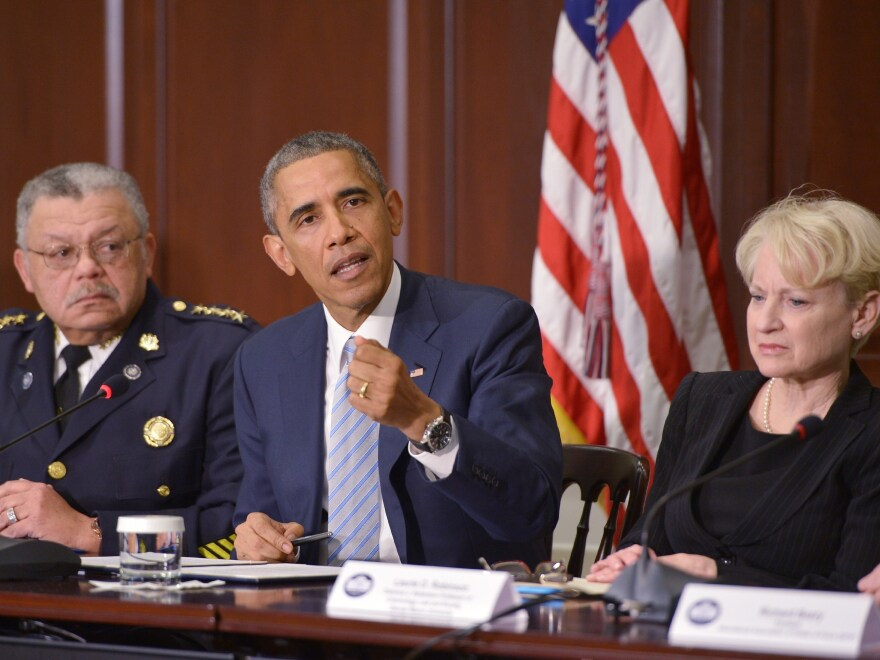 President Obama announces the creation of a policing task force Dec. 1 as Philadelphia Police Commissioner Charles Ramsey (left) and George Mason University criminology professor Laurie Robinson look on.