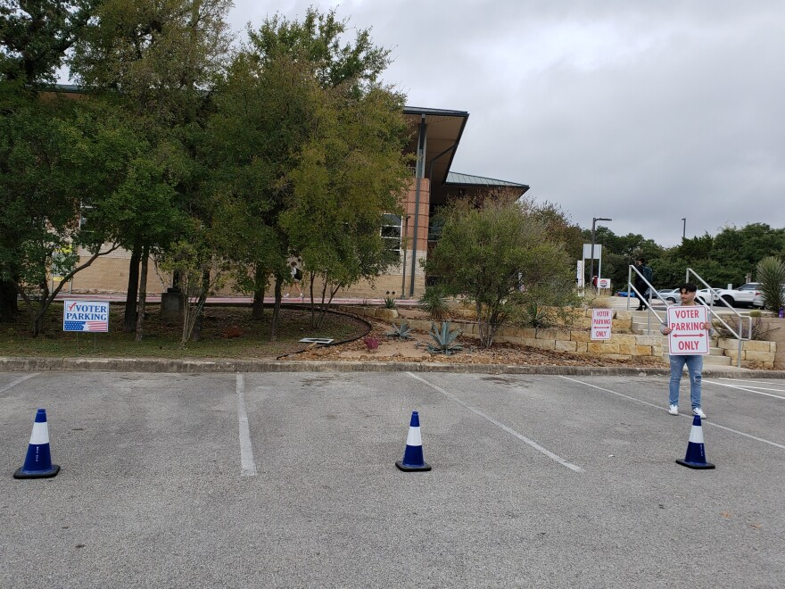 Matthew Campos stands in an empty parking lot at Northwest Vista College, a Bexar County polling place, during the election on Nov. 5, 2019.
