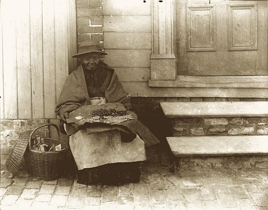 """Chloe Jenkins (1843-1899), photographed in Charleston circa 1897, was a so-called """"mauma,"""" a free black woman who sold the city's signature groundnut cakes for a penny each."""