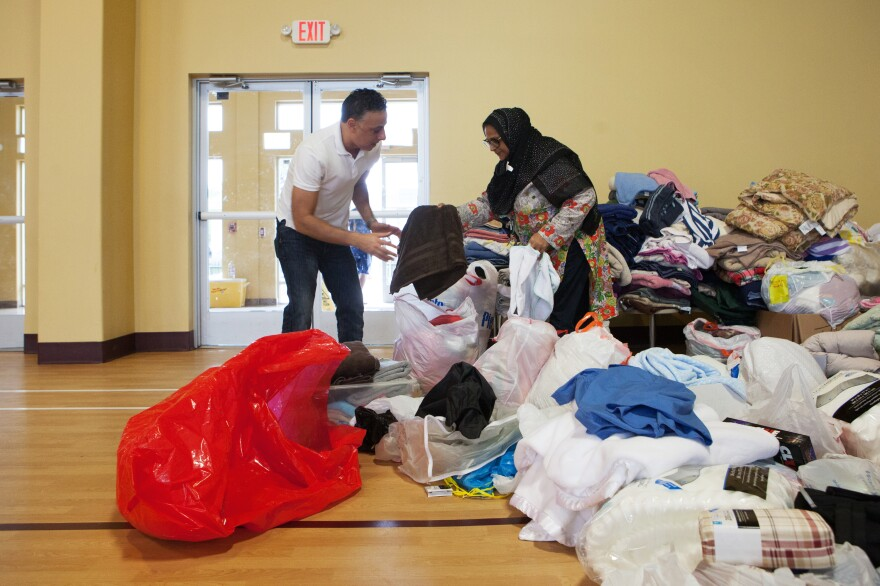 Kasin helps sort through the many donations that the mosque received.