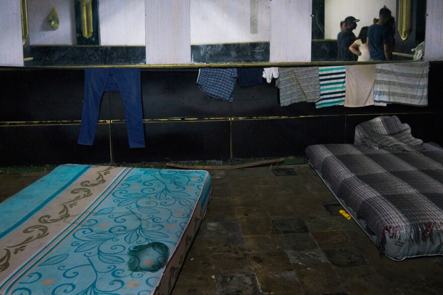 "Mattresses line the floor of a hotel basement in Juárez, where migrants are waiting to enter the U.S. Many crossed the border and were then returned to Mexico as part of the ""remain in Mexico"" policy."