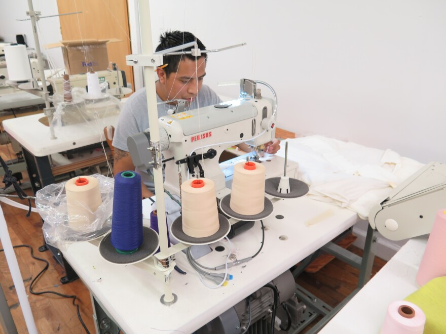 Worker-owner Alfonso Gonzalez pieces together Zady's T-shirts at the Opportunity Threads cooperative in Morganton, N.C.