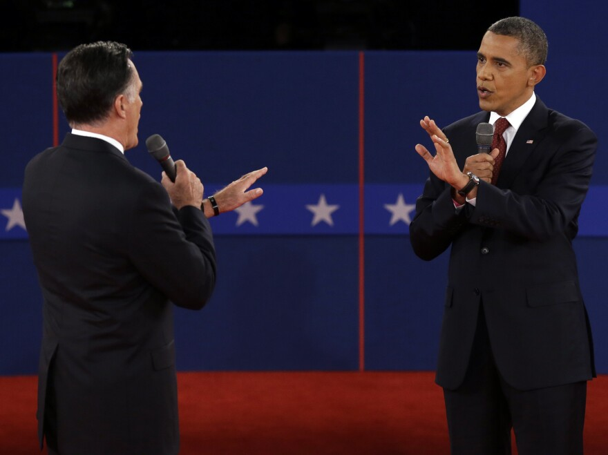 Republican presidential nominee Mitt Romney and President Obama spar over energy policy during the second presidential debate at Hofstra University on Tuesday.