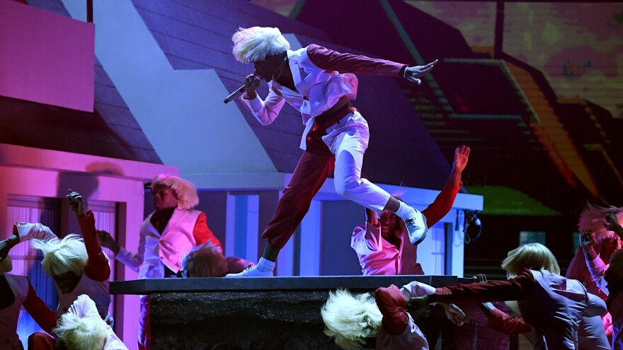 Tyler, the Creator (center) performs with a troupe of lookalike dancers during the Grammys.
