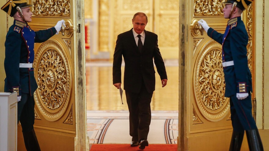Russian President Vladimir Putin enters a hall in the Kremlin before a meeting in 2015.