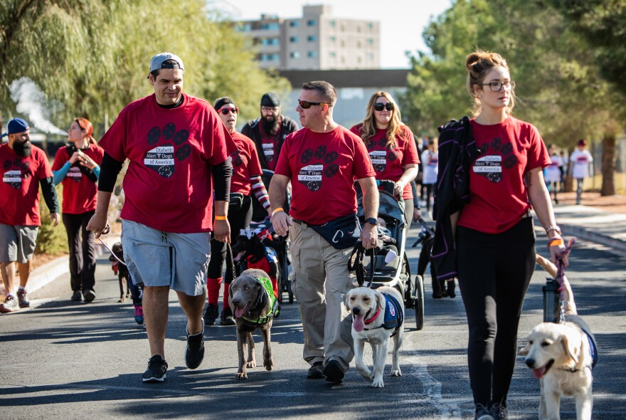 Ed Peeples (center) takes part in the JDRF One Walk, which raises money to research Type 1 diabetes, in Las Vegas. Peeples is a co-owner of the company Diabetic Alert Dogs of America.