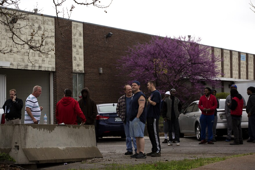 Loy-Lange Box Company employees watch as the fire department assesses damage. (April 3, 2017)