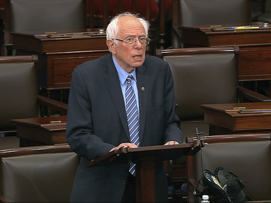 Sen. Bernie Sanders, I-Vt., is pushing for a commitment to vote to include another round of stimulus checks in a coronavirus relief package before agreed to move ahead on a one-week funding bill.