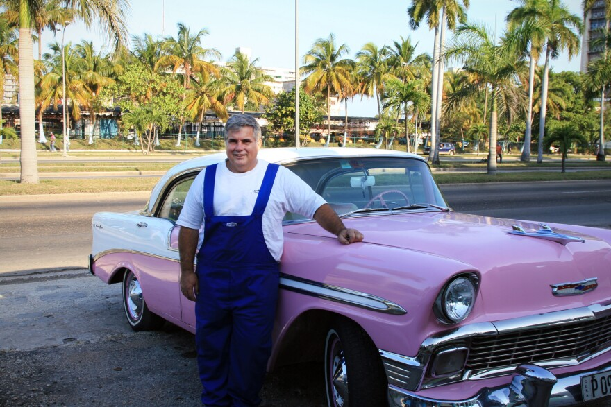 Julio Alvarez standing in front of Lola, a 1956 Chevy Bel Air.