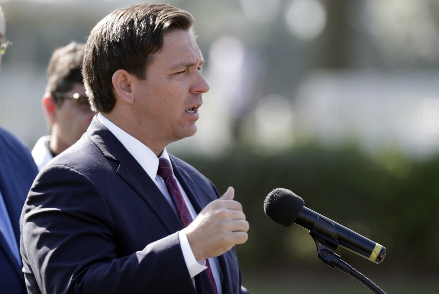 Florida Gov. Ron DeSantis delivers remarks during a press conference at a coronavirus mobile testing site Monday, March 23, 2020, in The Villages, Fla.