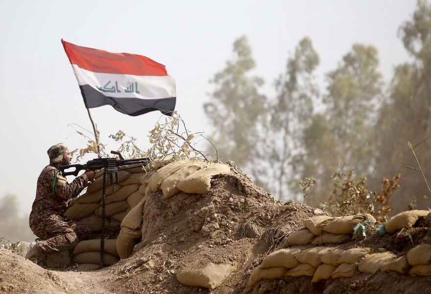 An Iraqi Shiite militia fighter holds a position in Salahuddin province, north of Baghdad, on May 26. With the Iraqi military performing poorly, militias have played an increasingly important role in the fight against the Islamic State.