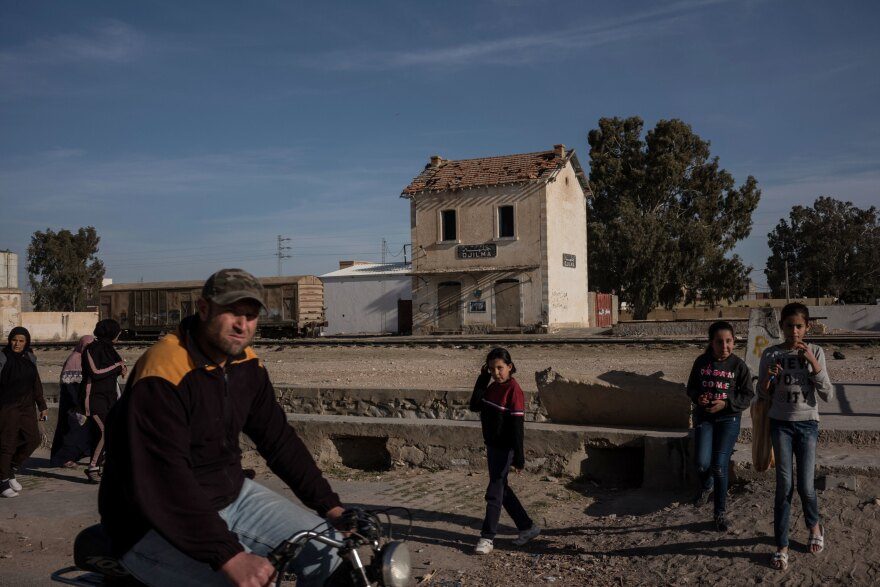 Residents of Jelma, Tunisia are seen near the town's abandoned train station on February 29. Jelma is located about 21 miles from Sidi Bouzeid, where in 2011 Mohamed Bouazizi died after setting himself on fire. His death kicked off popular youth-led protests and ultimately, the Arab Spring.