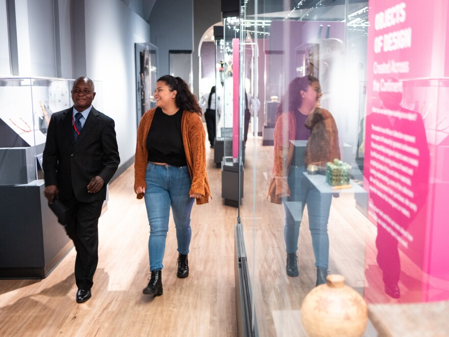 Clay Katongo, left, was born in the Democratic Republic of the Congo and is a guide for the Penn Museum's Africa Galleries. Celeste Diaz, who traveled back and forth with her family between Guatemala and Texas, works in the Mexico and Central America Gallery.