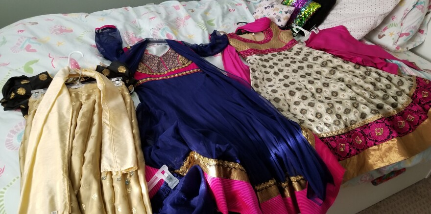 The traditional Indian clothing of Sarita Talusani Keller's daughter, 9-year-old Leela, is laid out in her bedroom. Every Diwali, she would wear one of these outfits to celebrate the festival.