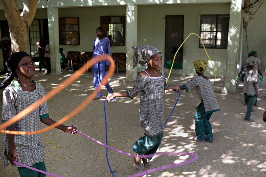 Students jump rope during recess at a school for orphaned children in Maiduguri, Nigeria, where many have a parent who was killed by Boko Haram.