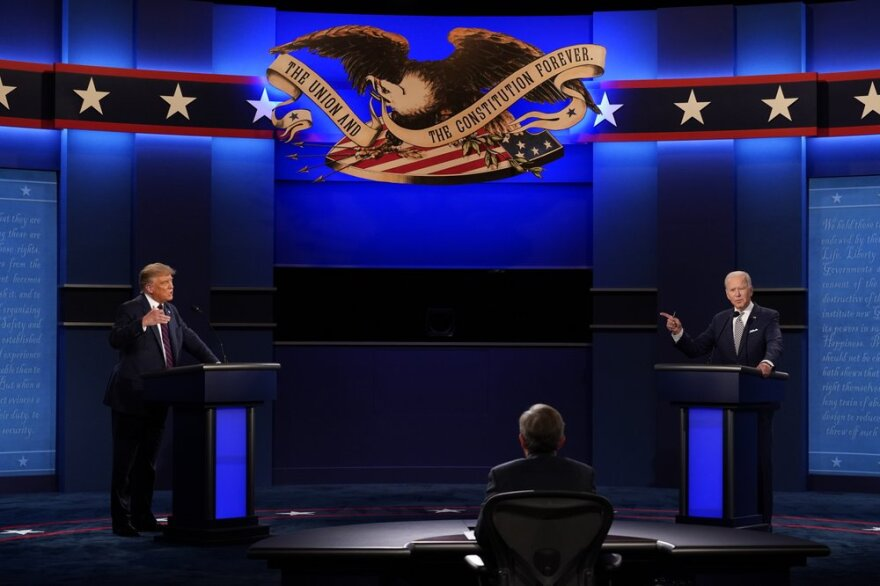 President Donald Trump and former Vice President Joe Biden talk during the first presidential debate on Sept. 29, 2020.