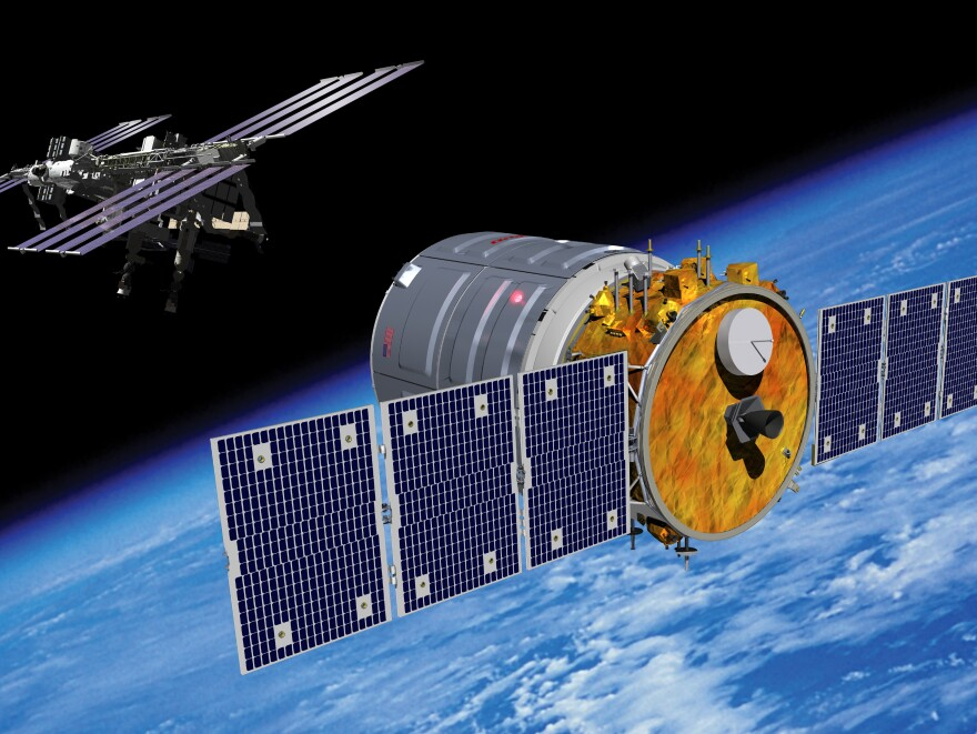 An artist's rendering of the Cygnus spacecraft approaching the International Space Station.