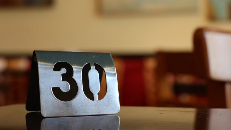 Photo of a number on a table in a restaurant
