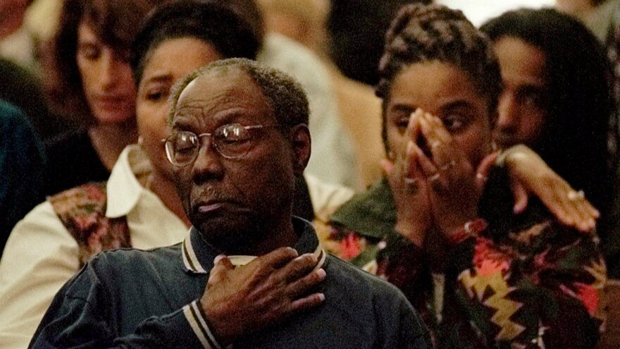 James Byrd Sr. and his granddaughter Renee Mullins (right) react to the sentencing of John William King to death in Jasper, Texas. King was convicted for the dragging death of James Byrd Jr. in the summer of 1998.