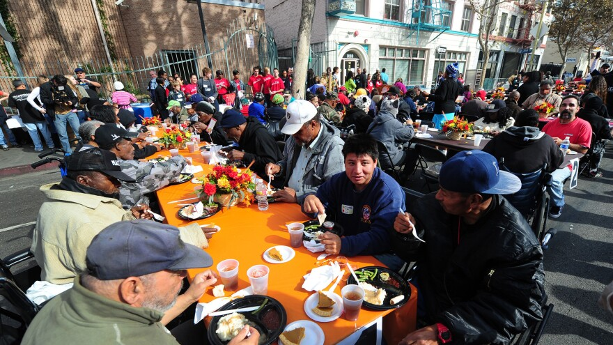 The homeless and others in need enjoy lunch at the Los Angeles Mission on Nov. 23, 2011, in celebration of Thanksgiving. Legislation to ban organizations from serving food to homeless people in public places has been proposed in Los Angeles.