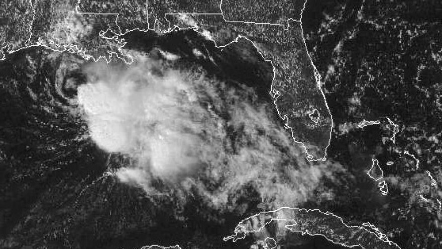 A GOES satellite handout photo provided by the National Oceanic and Atmospheric Administration shows Tropical Storm Karen churning in the Gulf of Mexico on Saturday afternoon. Karen, the second named storm to hit the U.S. this hurricane season, has weakened into a tropical depression.